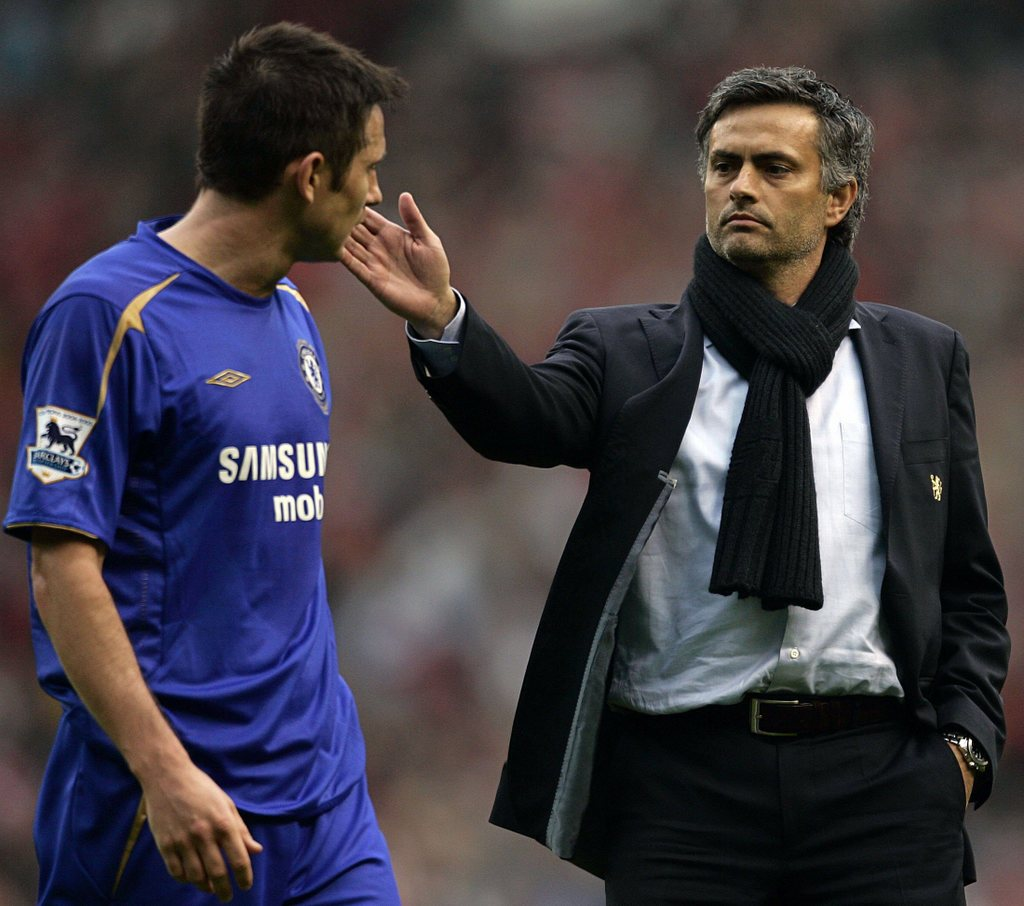 Chelsea's manager Mourinho consoles Lampard after loss to Liverpool during FA Cup semi-final soccer match at Old Trafford in Manchester